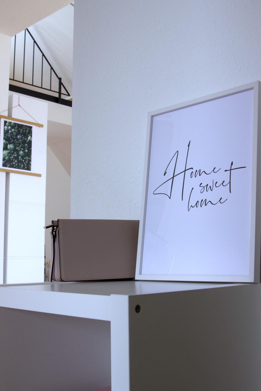 Posterstore_Poster Home Sweet Home_weißer Bilderrahmen